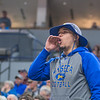 An outspoken Waseca fan gives the boys basketball team encouragement as the Bluejays faced De La Salle in the Class AAA boys basketball championship game played at Target Center. Photo by Jackson Forderer