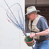 Mark Braun carries fishing equipment around the set of On Golden Pond during a rehearsal for the play on Tuesday. Braun is playing one of the main characters Norman Thayer in the production. Photo by Jackson Forderer