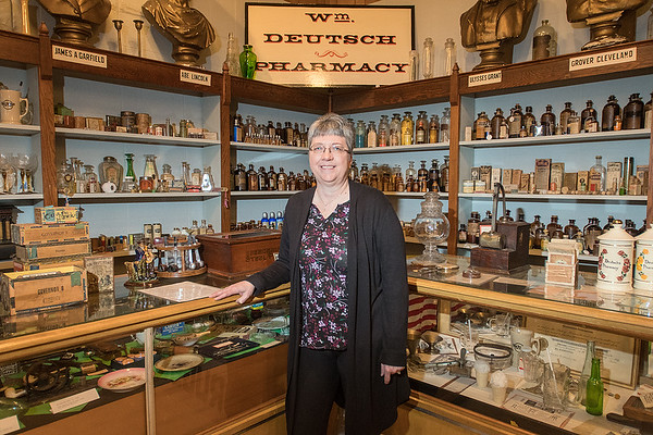 Pam Sandbo, new director of the Watonwan County Historical Society, in the pharmacy display at the society. Sandbo, who had experience volunteering at the St. James museum, was asked to come and help last April as the former director attended to medical issues. Photo by Jackson Forderer