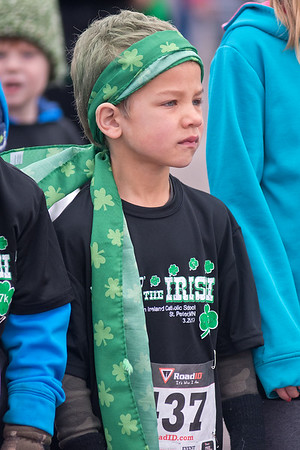 Isaiah Homrighausen, 5, waits at the starting line for the .7K kids race during the fourth annual Luck of the Irish run held in St. Peter on Saturday. The run benefits the John Ireland School and includes a 7K race and a .7K race.<br /> Photo by Jackson Forderer
