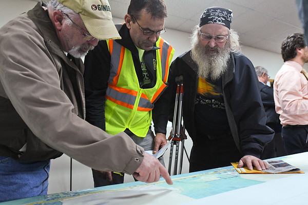 From left, Dennis Fude, Randy Huiras and Richard Wishart  go over a detailed map of the upcoming construction to Highway 22 between Mapleton and Mankato on Tuesday at Mapleton's Fire Hall. Highway 22 has had its original concrete in place since 1947. Photo by Jackson Forderer