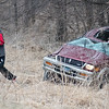 A passenger walks away from a vehicle that was involved in an accident in the northbound lane of Highway 169 just south of the Traverse Des Sioux Treaty Center in St. Peter. The driver of the vehicle was not wearing a seatbelt, was ejected and airlifted to a hospital. Photo by Jackson Forderer
