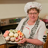 "Sue Weingartz shows a variety of cupcakes she made for her home business ""I Do"" Cakes and More. Her business mainly caters to cakes and cupcakes for weddings and special occasions. Photo by Jackson Forderer"