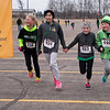 From left, Lydia Yost, Emily Deshayes, Emma Volk-Warning and Brooklyn Schmidt near the finish line hand-in-hand during the Luck of the Irish .7K kids run in St. Peter on Saturday. The fourth annual run benefits the John Ireland School in St. Peter. Photo by Jackson Forderer