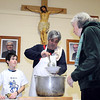 Gerard Aloisio and his son Salvatore, 8, serve soup at Holy Rosary Catholic Church.