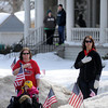 John Cross<br /> Spectators along funeral process route for Lance Cpl. Caleb Erickson watch from the street and porches as it passes on Monday.