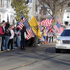 Pat Christman<br /> People line the road as a hearse carrying the body of Marine Lance Cpl. Caleb Erickson arrives in Waseca Saturday. Erickson was killed last week by a suicide bomber while serving in Afghanistan.