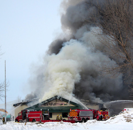 Mark Fischenich<br /> Smoke billows from a fire at WW Blacktopping located off of Industrial Road on Sunday.