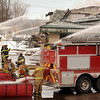 John Cross<br /> Firefighers from surrounding community fire departments battle a blaze on Sunday that destroyed WW Blacktopping locating on Industrial Road on the north end of Mankato.