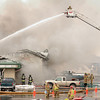 John Cross<br /> Firefighters from Mankato and surrounding communities battle a blaze at WW Blacktopping located on Industrial Road at the north end of Mankato on Sunday.