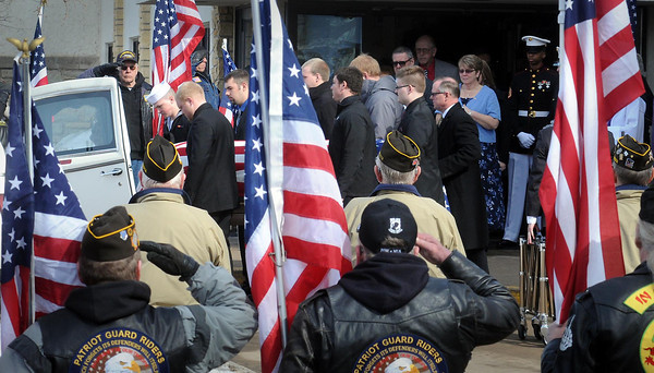 John Cross<br /> Marine Lance Cpl. Caleb Erickson's casket is placed in a hearse following a funeral service Monday at Grace Lutheran Church in Waseca.