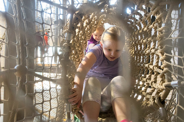 Annie Reyelts, 7, leads her sister Julia Reylets, 3, through a net in the playground area at the Children's Museum of Southern Minnesota on Thursday. The museum is asking the Minnesota Legislature for $400,000 to expand its programs outside of the the museum. Photo by Jackson Forderer