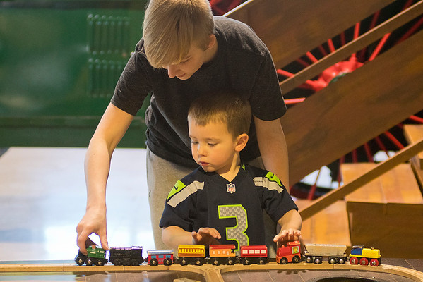 Autumn Kraudy helps her son Jep-Stanley Miller, 2, play with a train set at the Children's Museum of Southern Minnesota on Thursday. The museum is asking for funding for a variety of programs and objectives from the Minnesota Legislature. Photo by Jackson Forderer