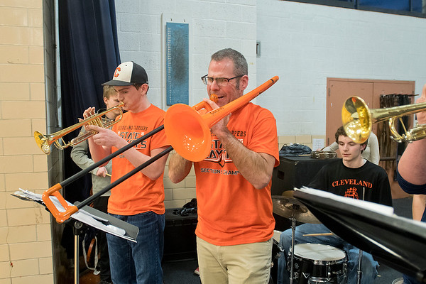 Cleveland's band director Erik Hermanson plays trombone as the pep band played before a boys basketball game in St. Peter. Photo by Jackson Forderer
