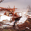 A St. Peter resident sorted through the rubble of her home for salvageable items shortly after a tornado hit the community, March 29, 1998. File photo
