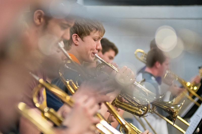 Eighth-grader Eric Rolfing plays the trumpet with fellow Cleveland pep band member before a Clippers basketball game against Mayer Lutheran. Photo by Jackson Forderer