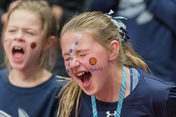 Kylie Southworth, 9, cheers on the St. Peter girls basketball team during introductions as the Saints took on Minnehaha Academy in the first round of the Class AA state tournament. South worth is the daughter of head coach Bob Southworth. Photo by Jackson Forderer