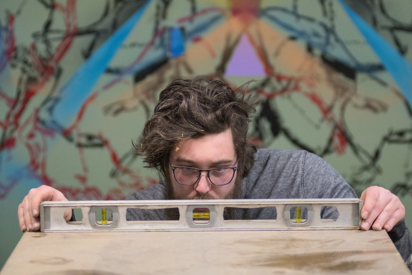 Joe Herke, co-founder of Mankato Makerspace, levels out a table that he was making that will be used to shelve ceramic projects. Herke also serves as the ceramic shop lead at Mankato Makerspace. Photo by Jackson Forderer