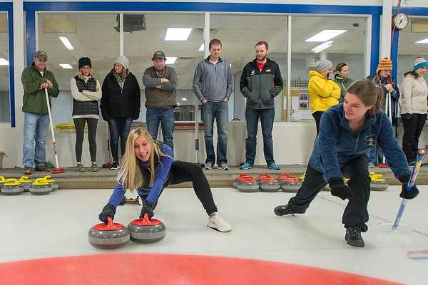 Kristin VanEck (left) tries to maintain her balance as instructor Suzie Gangi (right) teaches her how to come out of the hack at a Learn to Curl class at the Mankato Curling Club on Friday. The popularity of curling in the area has grown after the U.S. men's team, including Mapleton-native John Landsteiner, won gold in Pyeong Chang. Photo by Jackson Forderer