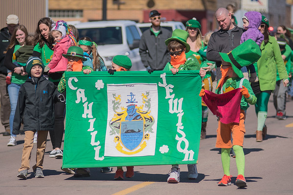 Holding the Cahill Jewison clan crest banner from left are Preston Johnson, Colin Schultz and Tyson Johnson as the St. Patrick's Day parade traversed along 2nd St. SW in Waseca on Saturday. Photo by Jackson Forderer