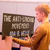 "Mankato West sophomore Hudson Hastings fastens the title sign onto his presentation board minutes before judges would assess his project at the South Central Regional History Day Competition held  at Minnesota State University's Centennial Student Union Monday. The contest, which had the theme ""Conflict and Compromise in History,"" brought together students from all over the south central  Minnesota with winners in various multimedia categories advnacing to the state contest. Photo by Casey Ek"