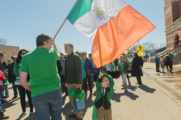 Louie Ross, 3, pokes at an Irish flag with the Mulcahey clan crest on it held by Tim Mulcahey at the start of the 50th Annual Irish American Club of Southern Minnesota St. Patrick's Day parade held in Waseca on Saturday.  Photo by Jackson Forderer