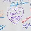 Taylor Powers left a message on a banner that St. Peter High School students signed, pledging that if they see something, they will say something. Photo by Jackson Forderer