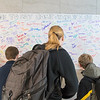 Students at St. Peter High School sign a banner pledging that if they see something, they will say something, at the conclusion of a rally as part of National School Walkout Day. Students walked outside of the high school where 17 signs displayed each of the victims from the Parkland, Florida shooting. Photo by Jackson Forderer