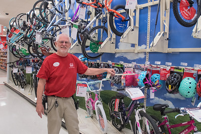 "Ron Spreng has worked at Target for the past two years, working on the sales floor and building bicycles. Spreng has previously worked as a welder, a captain in the Army Reserve, a chaplain and a professor. Spreng said he is an avid bicyclist and at age 69 said, ""I'll work until I get to the point where I physically can't work."" Photo by Jackson Forderer"