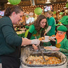 Kendra Hoehn (left) with Infinity Catering serves up Irish stew to Colin Schultz (right) and Julie Schultz (center) at the Starfire Event Center in Waseca on Saturday. People gathered for food, drink and entertainment in the ballroom following the 50th Annual Irish American Club of Southern Minnesota St. Patrick's Day parade. Photo by Jackson Forderer