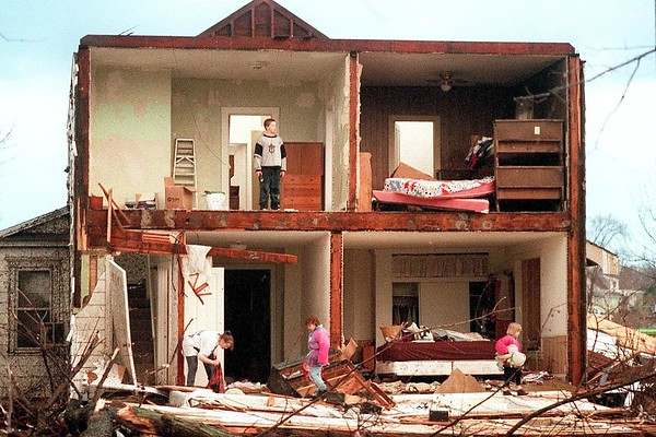 File photo<br /> Family members search for the family cat shortly after a tornado destroyed their North Fourth Street home in St. Peter, March 29, 1998.