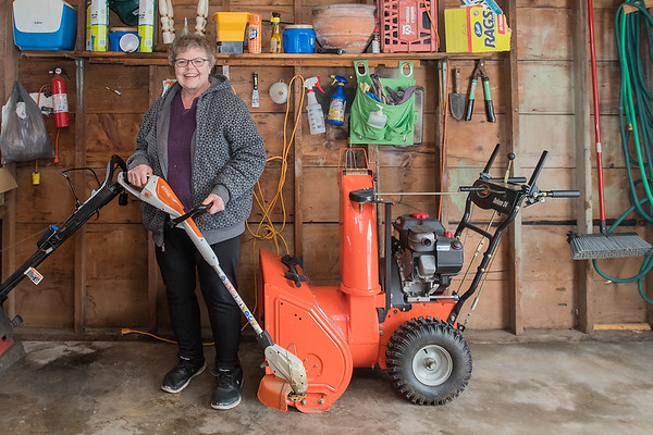Debbie Gjerde, who took VINE's Home Repair class last April, in her garage in Mankato. After her husband passed away seven years ago, she was left with many home repair jobs that she was unfamiliar with. She said the class taught her many things that made her life easier, such as purchasing non-oxygenated gas for her lawnmower, weed whacker and snowblower, but also to know when she is over her head and needs to call a professional. Photo by Jackson Forderer