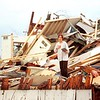 File photo<br /> Sarah (Jellif) Davis, then a Gustavus Adolphus College student, pauses from sifting through the rubble of her off-campus apartment that was destroyed by the March 29, 1998 tornado.