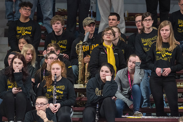 The Mankato East pep band looks lifeless as they watch the Cougars lose to Delano in the first round of the boys basketball state tournament. Photo by Jackson Forderer