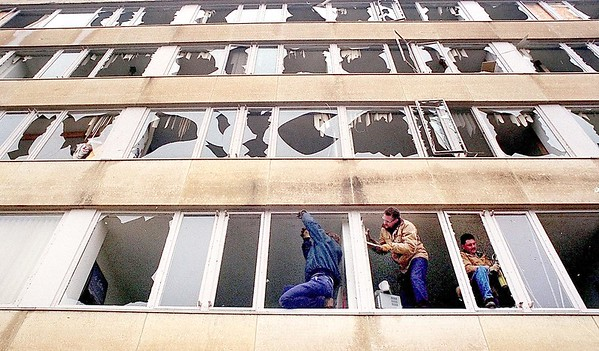 Workers remove broken glass in onc of the Gustavus Adolphus residence halls following the tornado. Students were on spring break when the storm struck. It is speculated that injuries from the storm would have been much higher if classes had been in session.