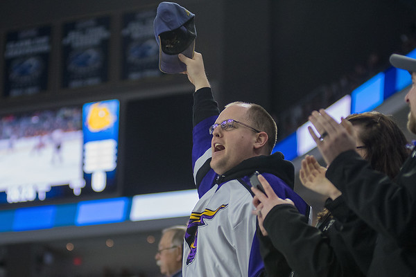 Chris Kaufman, an MSU alum who now lives in Vermillion, South Dakota, raises his hat in the air while celebrating the Mavericks second goal against the University of Minnesota Duluth in the first period of Friday's game played in Sioux Falls. Photo by Jackson Forderer