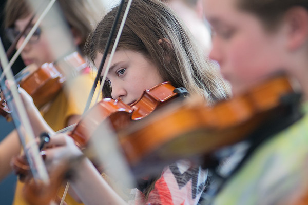 Kiah Dickinson plays the violin with her classmates during orchestra class taught by David Urness at Prairie Winds Middle School. Urness has been teaching orchestra for 39 years and will be retiring at the end of this school year. Photo by Jackson Forderer
