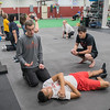 Jason Tompkins (left), owner of Ignition Fitness and Sports, talks with Izayah Harrison about Harrison's sore shoulder during a class at Ignition. Tompkins said they also work on strength and conditioning with different Minnesota State athletic teams. Photo by Jackson Forderer