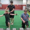 Trainer Matthew Merrick works with students in the Athlete Performance class at Ignition Fitness and Sports. The class works with ages 10 and up and owner Jason Tompkins said he hopes to be offering more classes for the age group in the future. Photo by Jackson Forderer