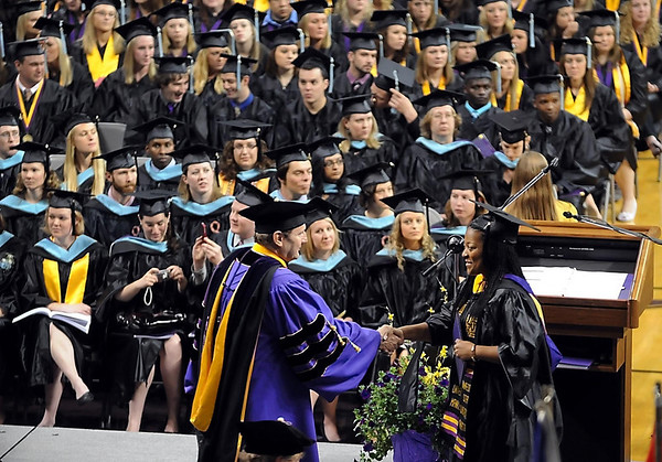 Minnesota State University President Richard Davenport congratulates graduates as they cross the stage Saturday during one of three commencement ceremonies at Bresnan Arena.