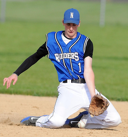 Nicollet shortstop Nick Erdman makes a sliding stop during the third inning against Maple River Tuesday in Minnesota Lake.