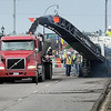 John Cross<br /> A machine grinds away asphalt from Madison Avenue east of Victory Drive Monday as work on a $5.3 million facelift of the busy street began in earnest Monday. The project, which will run from Seventh Street to Star Street, is scheduled to be completed by the end of August.