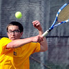 Mankato East's Chris Liu returns the ball against Mankato West's Eric Pipes during their match Thursday at the West courts.