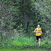Dan Ristau runs along a trail at Seven Mile Creek park near the end of the 7 at 7 trail race Saturday. Ristau won the 7-mile race through the park's trails.