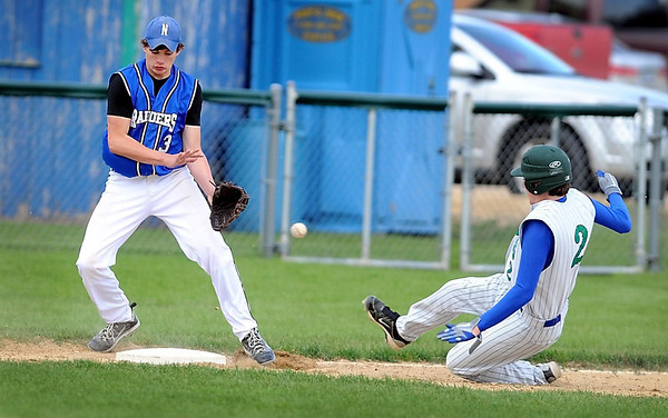 Nicollet's Jay Hendrycks can't handle the throw to third base as Maple River's Garret FitzSimmons slides into third base during the fourth inning of their game Tuesday in Minnesota Lake. FitzSimmons scored on the play.