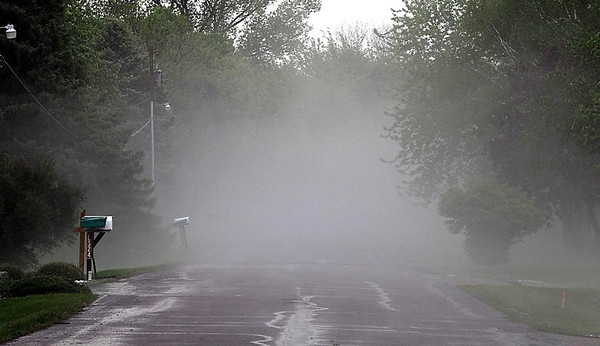An ominous fog hangs over Bittersweet Lane in Mankato Wednesday after a severe thunderstorm dumped dime and nickel sized hail on the neighborhood.