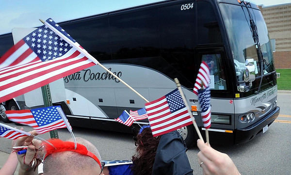 A bus returning the first contingent of Mankato-based 2nd Battalion 135th Infantry  National Guard members home from Kuwait is greeted with U.S. Flags Tuesday.