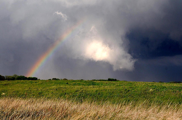 """A rainbow forms near ominous clouds on the back side of a severe thunderstorm that rolled through the Mankato area Wednesday evening. Widespread reports of hail as large as an inch were reported, but no tornado touchdowns in the Mankato area. For more photos from Wednesday's storm go to  <a href=""""http://www.mankatofreepress.com"""">http://www.mankatofreepress.com</a>."""