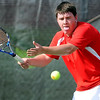 Mankato West's Eric Pipes returns a shot against Mankato East's Chris Liu during their match Thursday at the West courts.