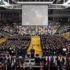 Graduates wait to cross the stage during one of three commencement ceremonies Saturday at Bresnan Arena.